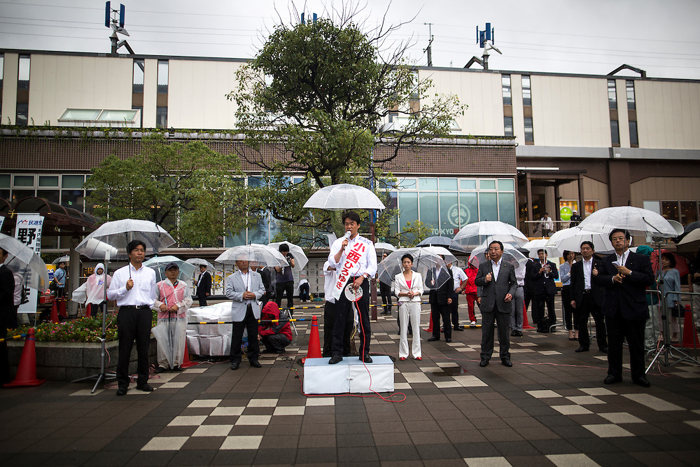 CHIBA, JAPAN - JULY 9 :  Hiroyuki Konishi, a Japanese politician from Democratic Party of Japan (DPJ) delivers campaign speech during the 2016 Upper House election campaign outside of Kaihin Makuhari Station in Chiba, Japan on July 9, 2016. Tomorrow, July 10, 2016 will be the first Upper house election nation-wide in Japan that 18 years old can vote after government law changes its voting age from 20 years old to 18 years old. (Photo by Richard Atrero de Guzman/NUR Photo)