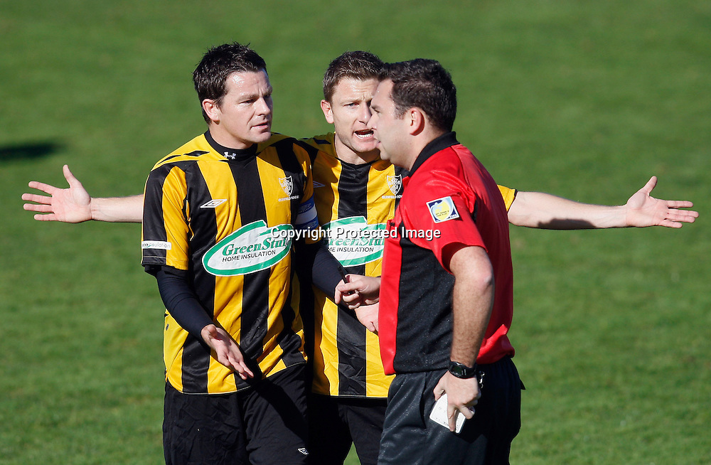 Rovers Liam Mulrooney (left) and James Pritchett protest referee Nick Waldron's decision to allow the goal. Chatham Cup Quarterfinal, East Coast Bays v Glenfield Rovers, Bays City Park, Auckland, Saturday 24th July 2010. Photo: Shane Wenzlick/PHOTOSPORT