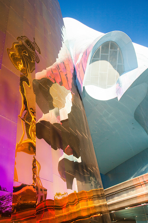 USA, Washington, Seattle. Space Needle reflected in Experience Music Project Museum.
