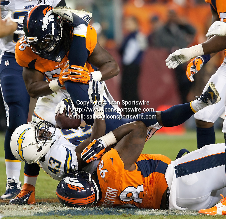 Oct. 23, 2014 - Denver, Colorado, U.S - Chargers RB BRANDEN OLIVER, center, gets gang tackled by the Broncos defense during the 1st. half at Sports Authority Field at Mile High Thursday Evening. The Broncos beat the Chargers 35-21