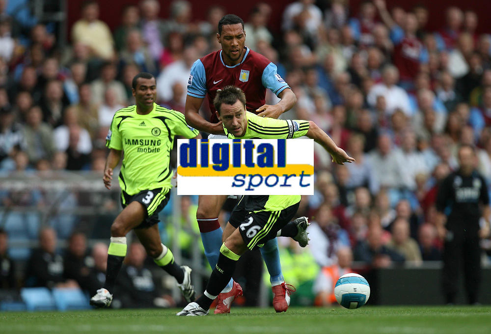 Photo: Rich Eaton.<br /> <br /> Aston Villa v Chelsea. The FA Barclays Premiership. 02/09/2007. Aston Villa's John Carew (l) is beaten to the ball by Chelsea's John Terry (r).
