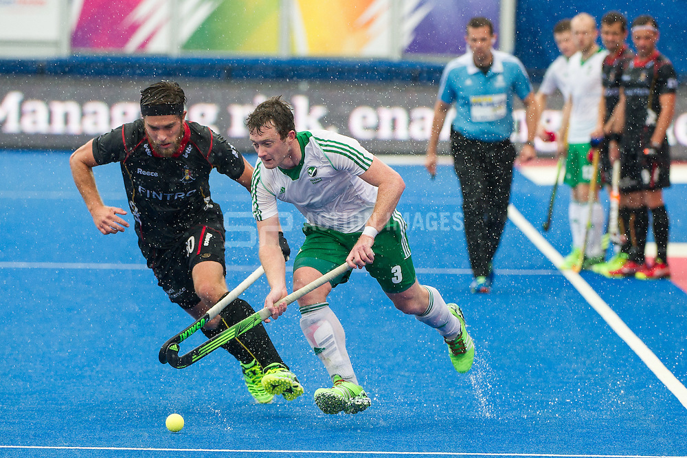 Ireland's John Jackson is shadowed by Cedric Charlier of Belgium. Ireland v Belgium - Unibet EuroHockey Championships, Lee Valley Hockey & Tennis Centre, London, UK on 25 August 2015. Photo: Simon Parker