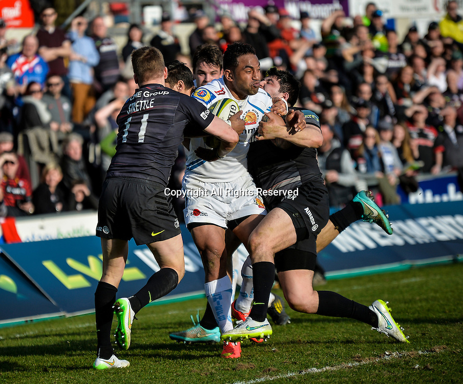 22.03.2015.  Northampton, England. LV Cup Final. Saracens versus Exeter Chiefs. Fetu'u Vainikolo (Exeter Chiefs) is tackled by David Strettle (Saracens) meters from the Saracens try line.