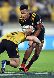 Chiefs Johnny Fa'auli tackled by Hurricanes Jamie Booth in the Super Rugby match at Westpac Stadium, Napier, New Zealand, Friday, April 13, 2018. Credit:SNPA / Ross Setford