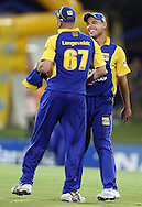 CENTURION, SOUTH AFRICA - 9  January 2009, Cobras Captain commiserates with Charl Langeveldt after he suffered 3 sixes and a single in one over of the batting of Gulam Bodi and Roelof van der Merwe during the MTN Domestic Championship Semi Final match between The Nashua Titans and The Nashua Cape Cobras held at SuperSport Park, Centurion, South Africa..Photo by Barry Aldworth/SPORTZPICS