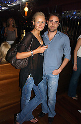 KALITA AL-SWAIDI  and ARIS PISSIOTIS at a party hosted by Allegra Hicks and Melissa Del Bono to celebrate the opening of Volstead, Swallow Street, London W1 on 4th May 2006.<br />