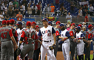 March 12, 2017 - Miami, FL, USA - United States right fielder Giancarlo Stanton shakes hands with Canada catcher Mike Reeves after a World Baseball Classic first round Pool C game on Sunday, March 12, 2017 at Marlins Park in Miami, Fla. The United States won 8-0. (Credit Image: © David Santiago/TNS via ZUMA Wire)