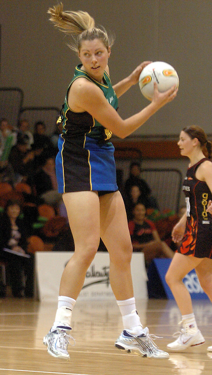 Flyers GS Hayley Stockman in action during the National Bank Cup round 6 netball match between the Flyers and the Flames at the Pettigrew Green Arena, Napier, on Friday 2 June 2006. Photo: John Cowpland/PHOTOSPORT<br /> <br /> <br /> <br /> <br /> <br /> 020606