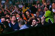 Fans enjoying the darts  during the Betway Premier League Darts at the Manchester Arena, Manchester, United Kingdom on 23 March 2017. Photo by Mark Pollitt.