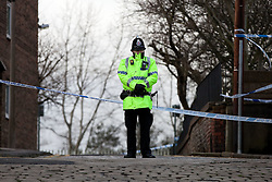 © Licensed to London News Pictures. 26/01/2012. Stockport, UK. Police and forensic officers examine the scene where the body of a man who had been decapitated and set alight was found in the early hours of this (Thursday 26th) morning. Photo credit : Joel Goodman/LNP