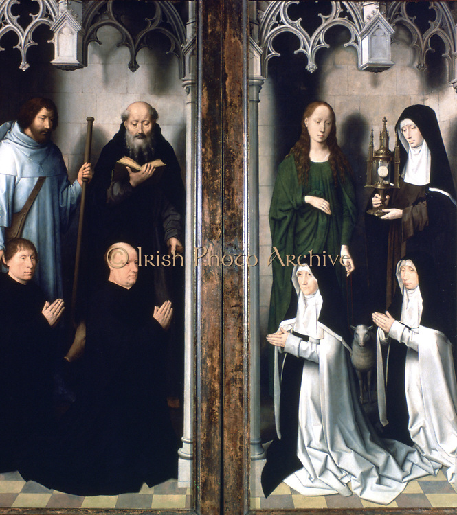 Altarpiece of St John the Baptist and St John the Evangelist, 1474-1479. Triptych. Oil on oak panel.  Hans Memling (1430/1440-1494) South Netherlandish painter. Portraits of the donors from the outside of the doors.