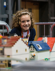 The SEC in Glasgow hosts Brick Live, the largest LEGO exhibition in the UK. Featuring models made up of over 6 million bricks, LEGO enthusiasts can build their own creations as well as admiring the models created by some of the leading designers including Scotland's Nick Clayton and Rocco Buttliere from Chicago.<br /> <br /> Pictured: Hope Crews (age 7) with a Fanzone Lego train-set