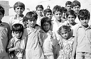 Crowd of children in desert oasis village of Rupsi