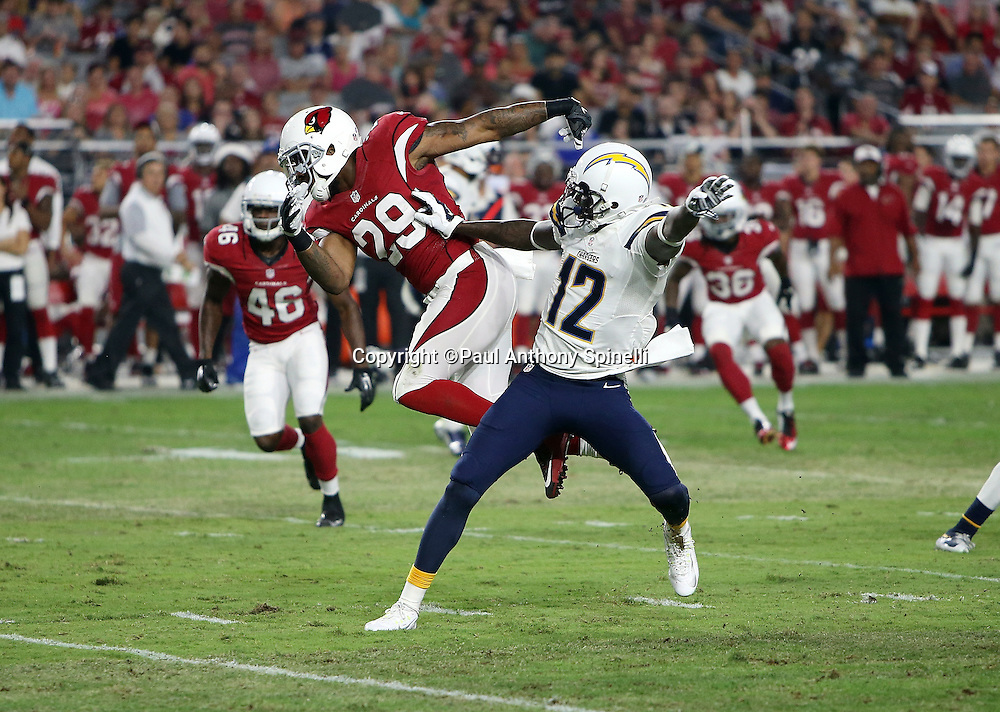 San Diego Chargers wide receiver Jacoby Jones (12) blocks Arizona Cardinals defensive back Chris Clemons (29) into the air during the 2015 NFL preseason football game against the Arizona Cardinals on Saturday, Aug. 22, 2015 in Glendale, Ariz. The Chargers won the game 22-19. (©Paul Anthony Spinelli)