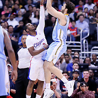 15 April 2014: Denver Nuggets guard Evan Fournier (94) takes a jump shot over Los Angeles Clippers guard Chris Paul (3) during the Los Angeles Clippers 117-105 victory over the Denver Nuggets at the Staples Center, Los Angeles, California, USA.