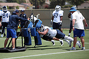 Los Angeles Rams rookie defensive end Trevon Young (49), a 6th round pick in the 2018 NFL draft, pushes a blocking sled during the Los Angeles Rams NFL football camp on Monday, June 4, 2018 in Thousand Oaks, Calif. (©Paul Anthony Spinelli)