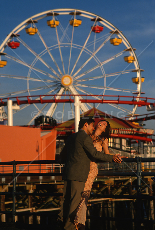 Romantic Couple On The Santa Monica Pier Near The Ferris Wheel