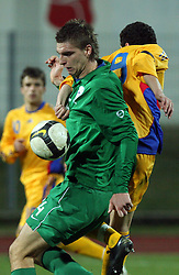 Jovan Vidovic (14)  of Slovenia vs Liuiu Ganea of Romania during Friendly match between U-21 National teams of Slovenia and Romania, on February 11, 2009, in Nova Gorica, Slovenia. (Photo by Vid Ponikvar / Sportida)