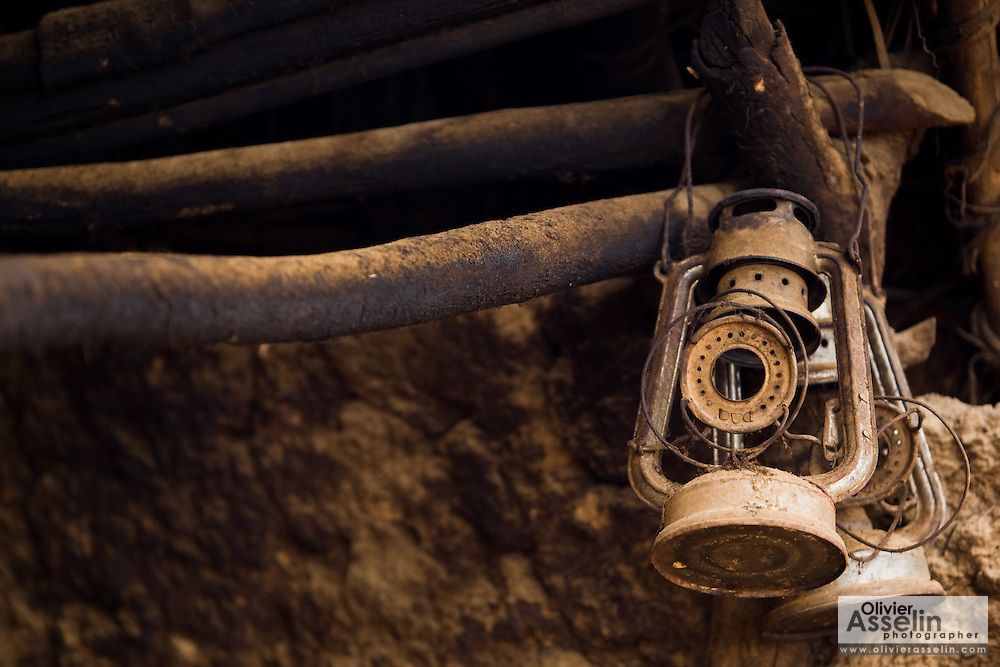 Old gas lamps hang from the side of a house in Tano Akakro, Cote d'Ivoire on Saturday June 20, 2009.