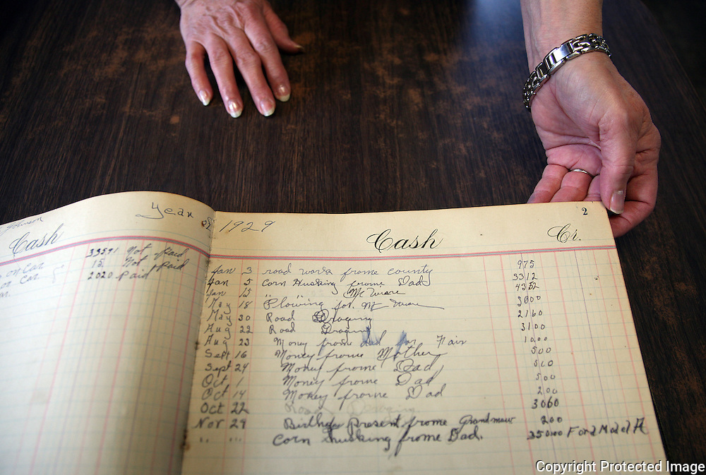 An old ledger, a family heirloom, shows recorded  purchases by the Johnson family in 1929.13USA, Des Moines, Ia.  Photo by David Peterson