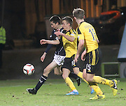 Cammy Kerr clears from Stefan Scougall and Ross Docherty - Dundee v Livingston,  SPFL Championship at Dens Park<br /> <br />  - &copy; David Young - www.davidyoungphoto.co.uk - email: davidyoungphoto@gmail.com
