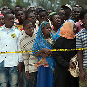 Anxious Zanzibar residents wait as bodies are carried from the sea.