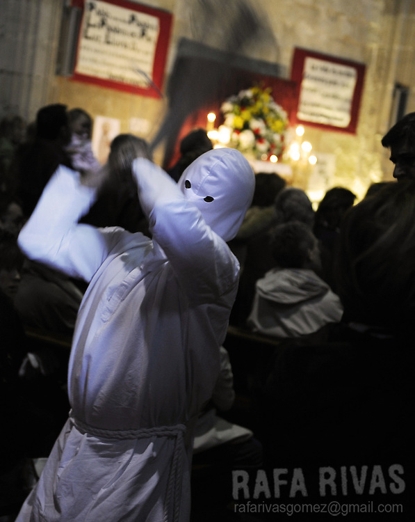 "A penitent (called ""Picao"") whips himself during the procession of the fellowship of Santa Vera Cruz this Holy Friday in San Vicente de la Sonsierra (330km north of Madrid, in La Rioja), on April 10, 2009. This traditional procession takes its origin in the XVI century."