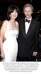 Leading charity figure MR & MRS DAVID HALLAM-PEEL,  at a fashion show in London on 15th April 2002.	OYY 63