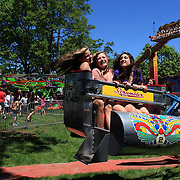 Teenage girls enjoy the fun rides during the May Fair at Saint Mark's Church, New Canaan, Connecticut, USA. 12th May 2012. Photo Tim Clayton