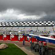 Storm clouds roll in during the qualifying practice session of the NASCAR Nationwide Drive4COPD 300 at Daytona International Speedway on Friday, February 21, 2014 in Daytona Beach, Florida.  (AP Photo/Alex Menendez)