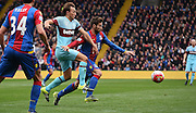 Mark Noble and Yohan Cabaye battle for posession during the Barclays Premier League match between Crystal Palace and West Ham United at Selhurst Park, London, England on 17 October 2015. Photo by Michael Hulf.