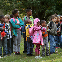 Adam Robison | BUY AT PHOTOS.DJOURNAL.COM<br /> A group of Verona Elementary School children wait in a yard along Green Tee road waiting for another school bus to pick them up after the one thy were riding ran off the road Wednesday afternoon.