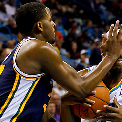 December 17, 2010; New Orleans, LA, USA; New Orleans Hornets point guard Jarrett Jack (2) takes a hit to the face by Utah Jazz power forward Paul Millsap (24) as he drives the lane past point guard Earl Watson (11) during the second half at the New Orleans Arena.  The Hornets defeated the Jazz 100-71. Mandatory Credit: Derick E. Hingle