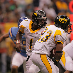 2008 November, 29: Grambling State quarterback Greg Dillon (1) hands off to running back Frank Warren (23) during a 29-14 victory by Grambling State University over Southern University during the 35th annual State Farm Bayou Classic at the Louisiana Superdome in New Orleans, LA.  .