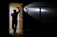 Ted Sanchez, a CCISD police officer at Grant Middle School, shines a light into a dark room as he searches for a mock gunman during an active shooter exercise at the old Lamar Elementary in Corpus Christi.
