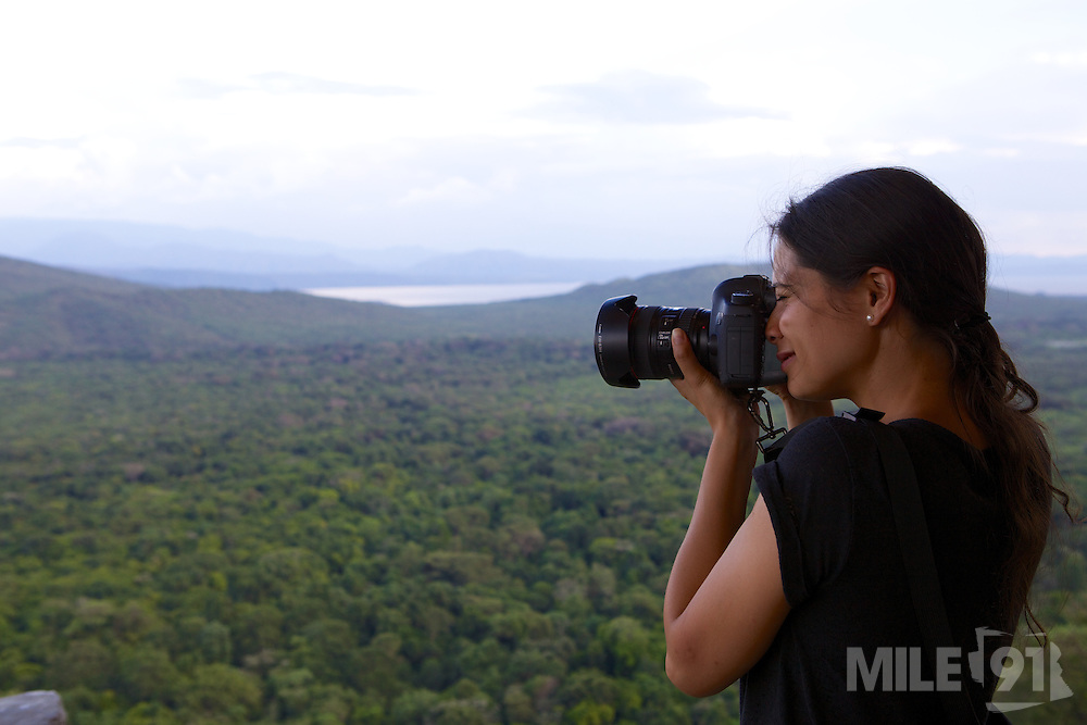 Ginny, taking a photo of the view across a rainforest, Ethiopia.
