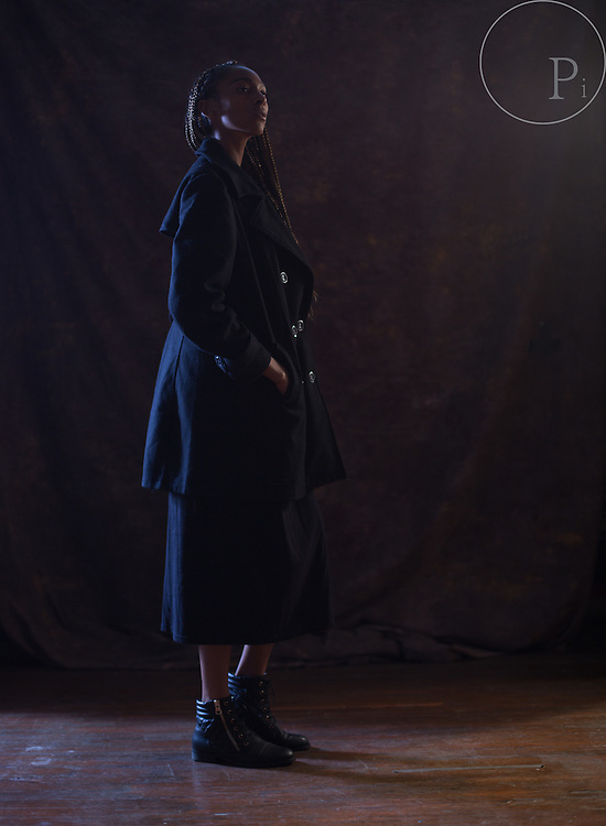 Blue jeans and black coats, inspiration for a fashion test shoot with L.A. Based Model Gmonay Houston. Photographer Lucky Wenzel. Studio West  located in Down Town Las Vegas.