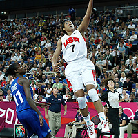 11 August 2012: USA Maya Moore goes for the layup past Emilie Gomis during 86-50 Team USA victory over Team France, during the Women's Gold Medal Game, at the North Greenwich Arena, in London, Great Britain.