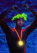 Yong man with glowing gold medal and olive wreath raises his hands in victory against a stark blue background.Black light