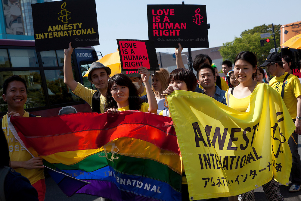 Members of Amnesty International parade during Tokyo Rainbow Pride festival, Yoyogi Park, Tokyo, Japan. Sunday April 27th 2014 This was the third year this annual gay-pride event has been held in Japan capital.with food, fashion and health care stalls and musical performances set up in Yoyogi Park event square and a colourful parade around Shibuya at 1pm.
