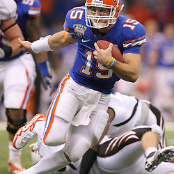 Jan 01, 2010; New Orleans, LA, USA; Florida Gators quarterback Tim Tebow (15) scrambles with the ball against the Cincinnati Bearcats during the first half of the 2010 Sugar Bowl at the Louisiana Superdome.  Mandatory Credit: Derick E. Hingle-US PRESSWIRE.