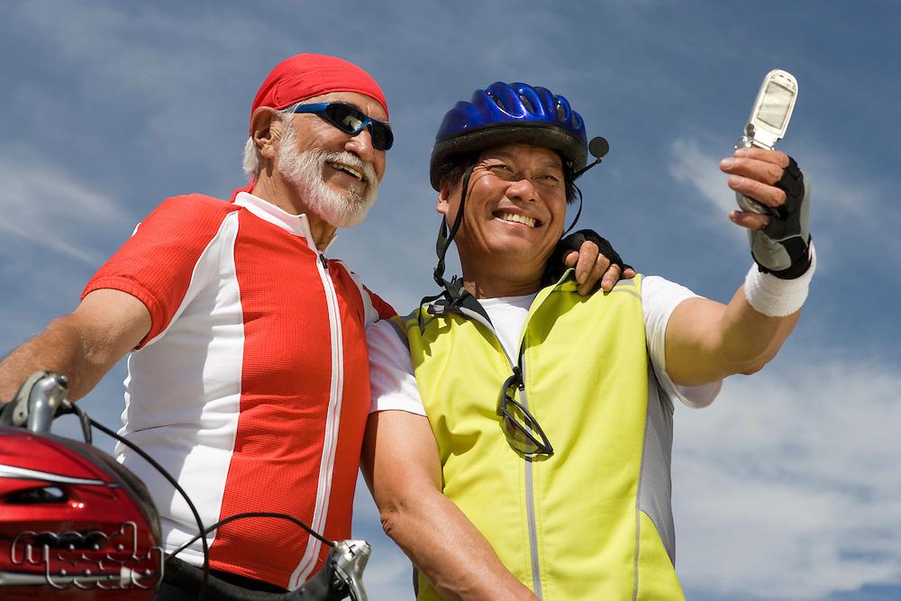 Two Senior men in sportswear photo messaging
