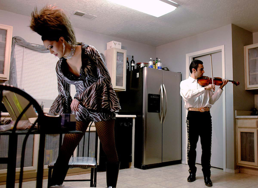 "Adan Branchal's partner, Joseph ""Anastasia"" Gutierrez, left, and Anthony Ortiz prepare for their own types of performances in Branchal's Albuquerque Westgate home Jan. 21, 2007. (Xavier Mascareñas)"