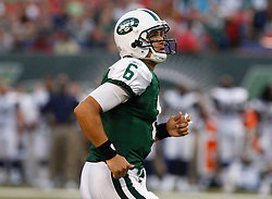 Aug 14, 2009; East Rutherford, NJ, USA;   New York Jets quarterback Mark Sanchez (6) runs on to the field before his first series during the first half at Giants Stadium.