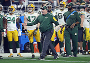 Green Bay Packers head coach Mike McCarthy yells out and waves his arms on the sideline as he complains about a third quarter holding call that gives the Arizona Cardinals a first down during the NFL NFC Divisional round playoff football game against the Arizona Cardinals on Saturday, Jan. 16, 2016 in Glendale, Ariz. The Cardinals won the game in overtime 26-20. (©Paul Anthony Spinelli)