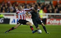 EXETER, ENGLAND - Wednesday, August 24, 2011: Liverpool's Jack Robinson in action against Exeter City's James Dunne during the Football League Cup 2nd Round match at St James Park. (Pic by David Rawcliffe/Propaganda)