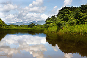 As fast as the storms come in, they leave, the clouds and sun mixing across the jungle and distant mountains. Rio Sambu, Darien Province, Panama.