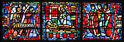 Fulbert lies in bed suffering from an illness and the Virgin appears and gives him one drop of her milk, which miraculously revives him. Angels on the left and men on the right bear witness to the miracle. The Miracle of the Virgin's Milk, from the Life of Fulbert stained glass window, in the south transept of Chartres Cathedral, Eure-et-Loir, France. Chartres is said to have held a relic of a vial with a few drops of the Virgin's milk. This window replaces the original 13th century window depicting the Life of St Blaise, which was destroyed in 1791. It was created in 1954 by Francois Lorin as a gift of the Institute of American Architects, on a theme chosen by the Canon Yves Delaporte. It depicts the life of Fulbert, bishop of Chartres in the 11th century. Chartres cathedral was built 1194-1250 and is a fine example of Gothic architecture. Most of its windows date from 1205-40 although a few earlier 12th century examples are also intact. It was declared a UNESCO World Heritage Site in 1979. Picture by Manuel Cohen