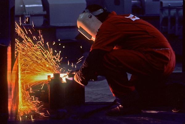 worker welding at a job site