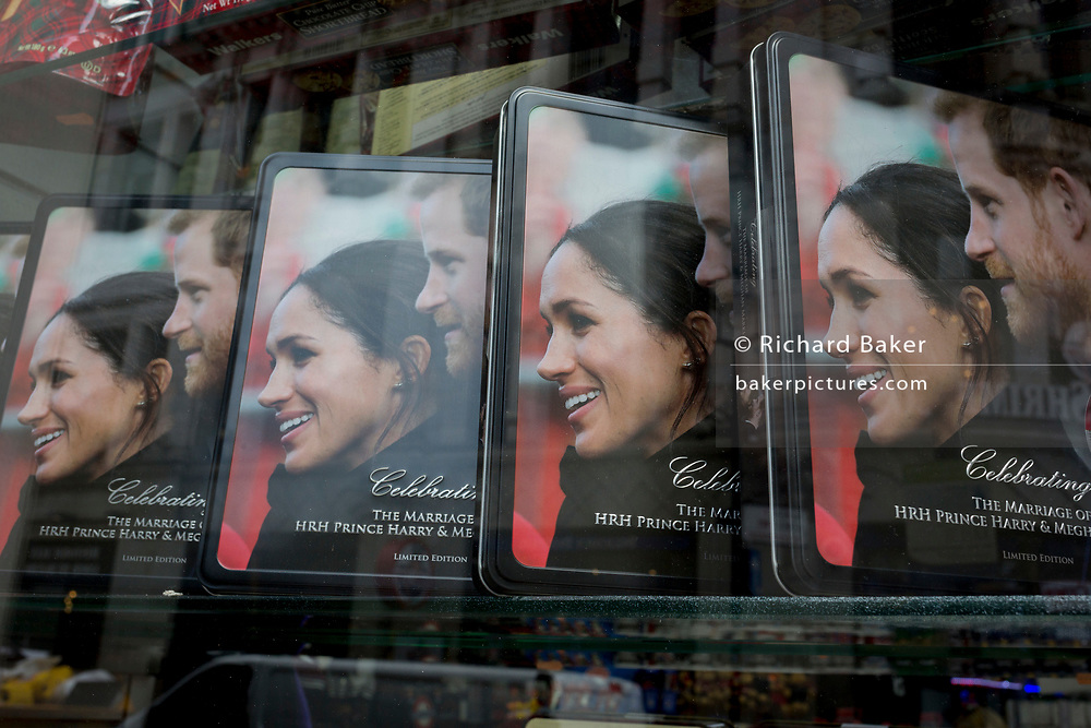 A week before royal wedding between Prince Harry and Meghan Markle, their faces adorn shortbread biscuit tins in the window of a tourist trinket shop near Piccadilly Circus, on 1st May, in London, England.